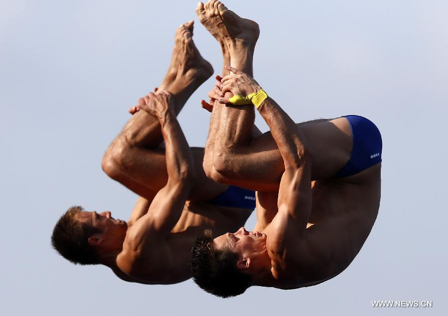 Germany's Sascha Klein (L) and Patrick Hausding compete during the men's 10m synchro platform final of the Diving competition in the 15th FINA World Championships at the Piscina Municipal de Montjuic in Barcelona, Spain, on July 21, 2013. Sascha Klein and Patrick Hausding claimed the title with a total socre of 461.46 points. (Xinhua/Wang Lili)