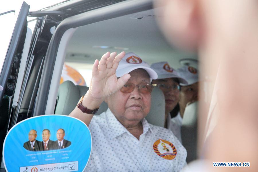 President of the Senate and President of the ruling Cambodian People's Party (CPP) Chea Sim waves to the party's supporters during a campaign rally in Phnom Penh, Cambodia, July 26, 2013. Cambodia's fifth parliamentary elections are ready to kick off on Sunday, a National Election Committee (NEC) official said Friday. (Xinhua/Phearum)