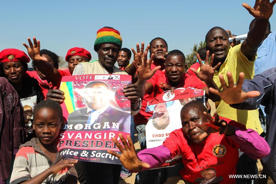 People gather at a campaign rally of presidential election candidate Morgan Tsvangirai in Chitungwiza of Harare, capital of Zimbabwe, July 28, 2013. Zimbabweans are expected to vote on July 31 to choose a president, legislators, and local councilors. Incumbent President Robert Mugabe and Prime Minister Morgan Tsvangirai are considered the main contenders for the presidency. (Xinhua/Meng Chenguang)