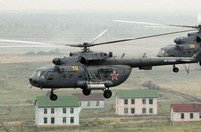Helicopters, tanks seen during China-Russia joint drill