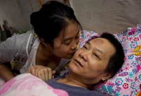 A girl takes care of paralyzed father for 10 years