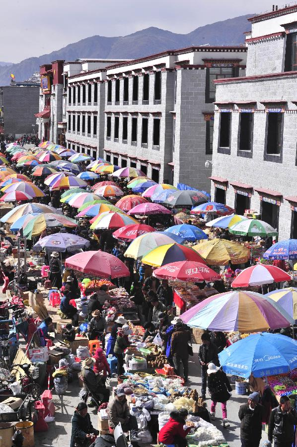 "People purchase goods for the coming Tibetan losar or the Tibetan New Year at a bazaar in Lhasa, capital of southwest China's Tibet Autonomous Region, Feb. 19, 2014. People of the Tibetan ethnic group will embrace the ""Wood Horse Losar"" on March 2. (Xinhua/Liu Kun)"